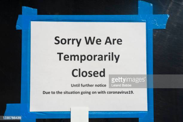 closed sign on store during covid-19 lockdown - business stock pictures, royalty-free photos & images