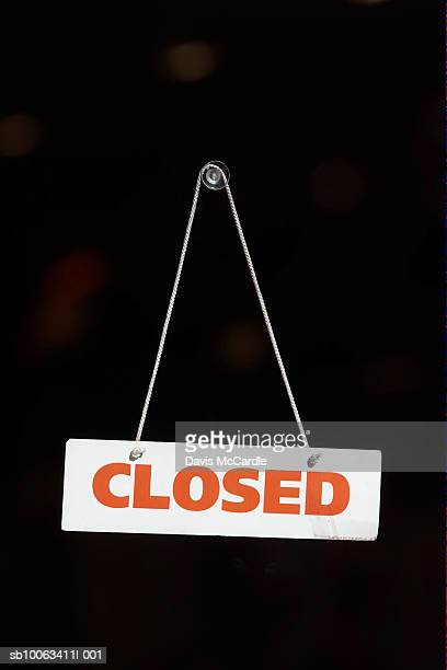 closed sign on the door of a store