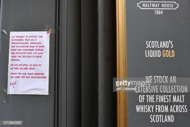A closed sign outside the Half Way House pub on March 17 2020 in Edinburgh ScotlandScottish people have been urged to avoid all nonessential travel...