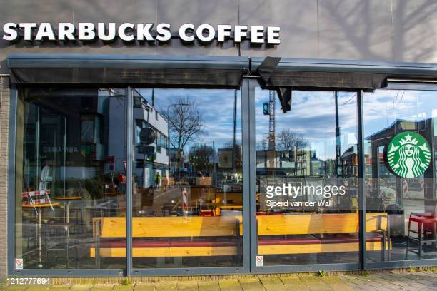 Closed Starbucks coffee bar after the Dutch government announced new measures for prevention of spreading of the Corona Covid-19 virus on March 16,...