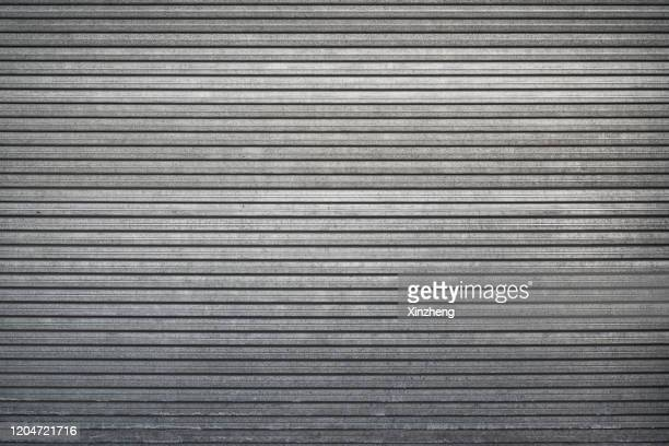 closed steel door / shop shutters - de rola imagens e fotografias de stock