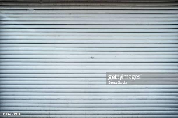 closed steel door / shop shutters - 建具 シャッター ストックフォトと画像