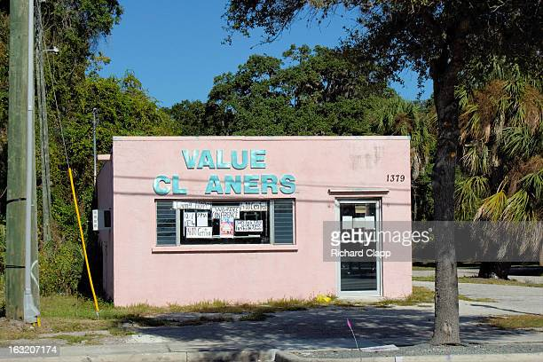 CONTENT] Closed storefront in Newtown the Sarasota FL AfricanAmerican Community The pink building has community notices on the windoe and door