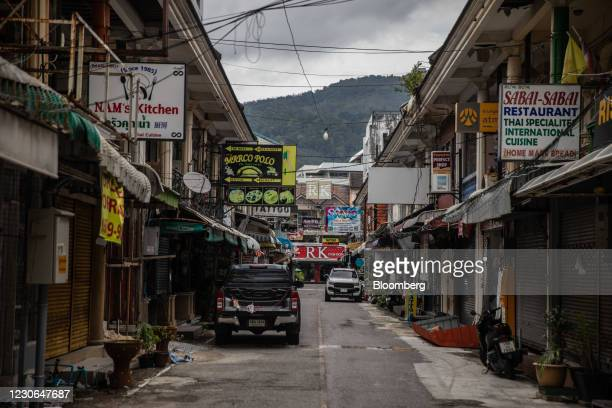 Closed stores in a deserted alleyway in Patong, Phuket, Thailand, on Sunday, Dec. 20, 2020. The tepid response to Thailands highly publicized...