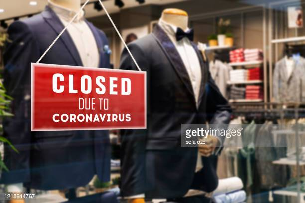 closed suit store due to coronavirus - closing stock pictures, royalty-free photos & images