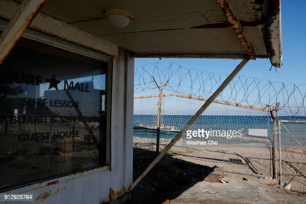 A closed surf shop is seen beside barbed wire along the beach in Yangyang Ganwon province in South Korea on February 1 2018 The North Korean athletes...