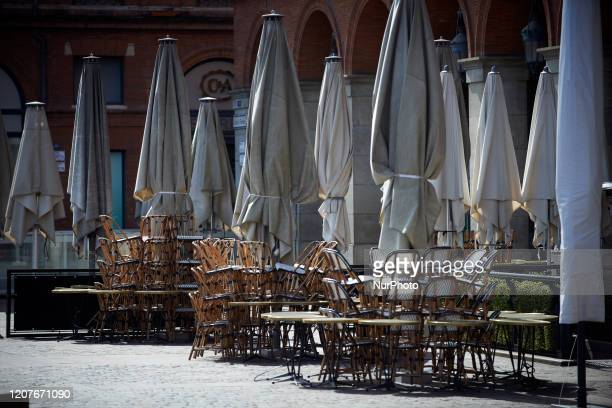 A closed terrace on the most iconic and touristic place of Toulouse France on March 19 2020 For the 3rd day French people are on lockdown Since March...