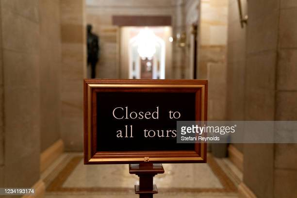 """Closed to all tours"""" sign is displayed at the U.S. Capitol on July 25, 2021 in Washington, DC. Lawmakers are working to finalize an infrastructure..."""