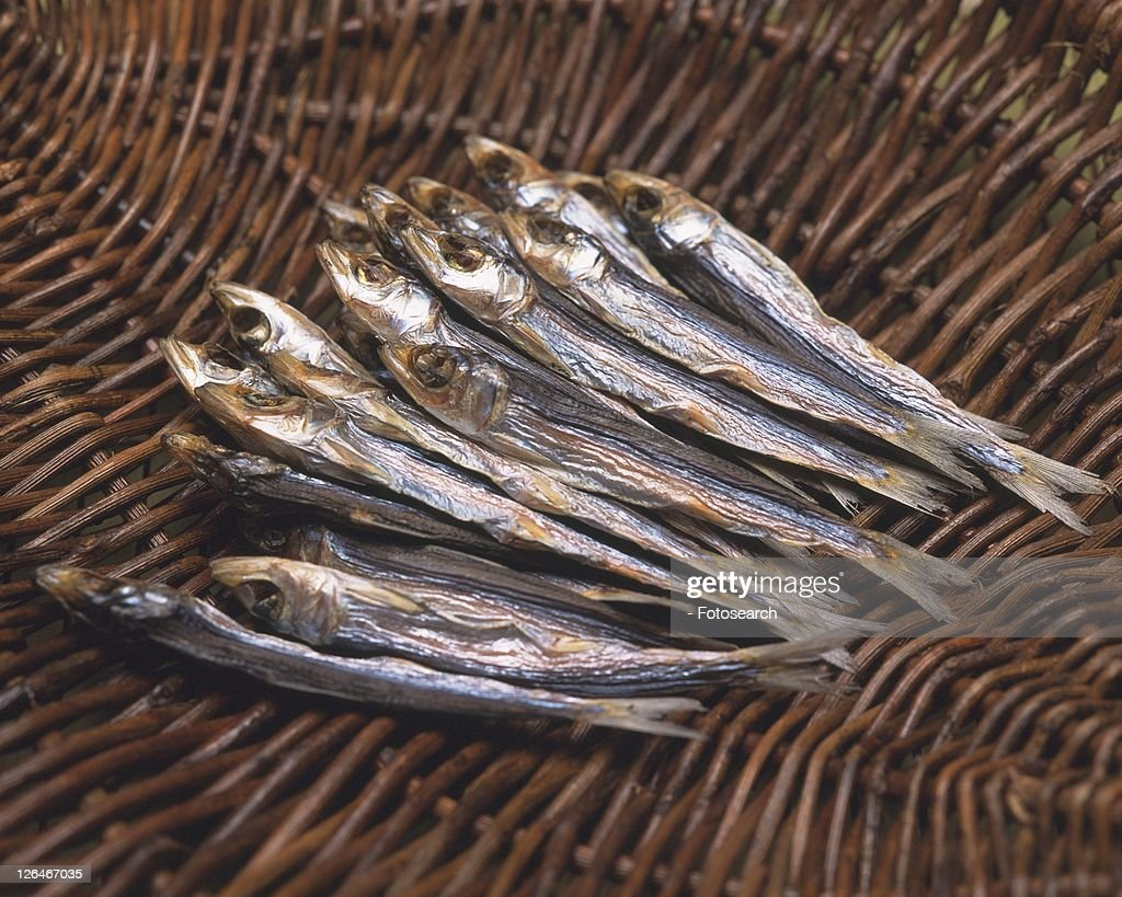 Closed Up Image of Several Pieces of Little Dried Fish on a Wooden Surface, High Angle View : Bildbanksbilder