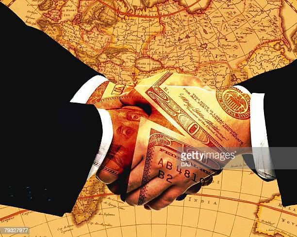 Closed Up Image of Two Businessmens Hands, Shaking, With Money Patterns On Their Hands, Toned Image, CG