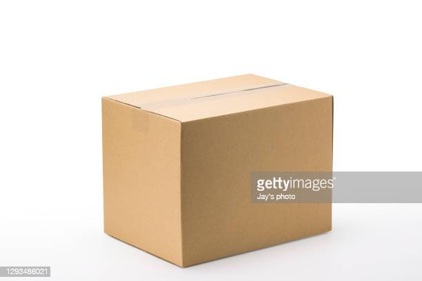 closed up shot paper box taped and isolated on a white background. - cardboard box stock pictures, royalty-free photos & images