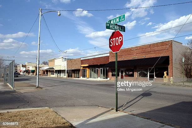 Closed up stores line up Main street in downtown Bentonville on March 15 2005 in Bentonville Arkansas WalMart founder Sam Walton opened his first...