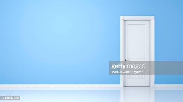 Closed White Door By Blue Wall