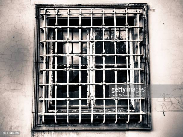 closed window of building - grille stock photos and pictures