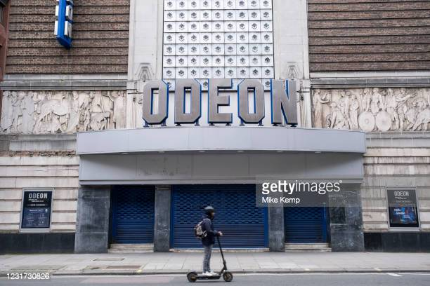 Closed with shutters down, the Odeon cinema on Shaftesbury Avenue as the national coronavirus lockdown three continues on 5th March 2021 in London,...