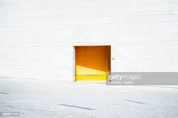 Closed Yellow Door Of Building