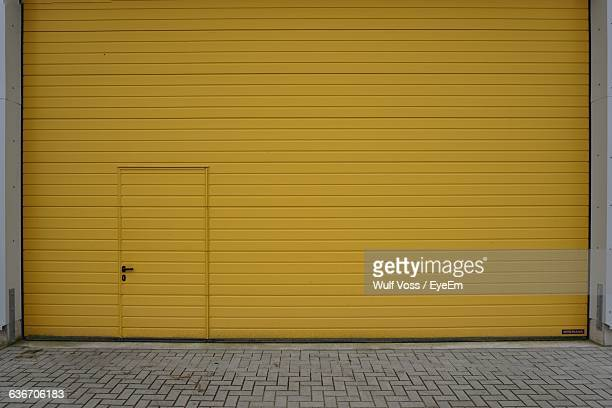 Closed Yellow Shutter Of Shop
