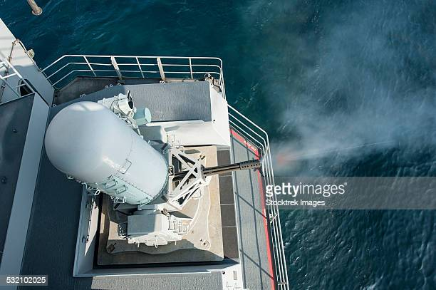 A close-in weapons system fires aboard USS Harry S. Truman.