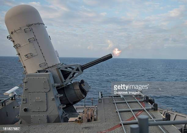 a close-in weapons system is fired aboard uss tortuga. - bang boat stock pictures, royalty-free photos & images
