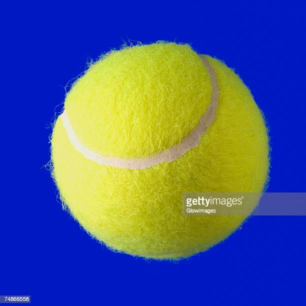 close-of a tennis ball - tennis ball stock pictures, royalty-free photos & images