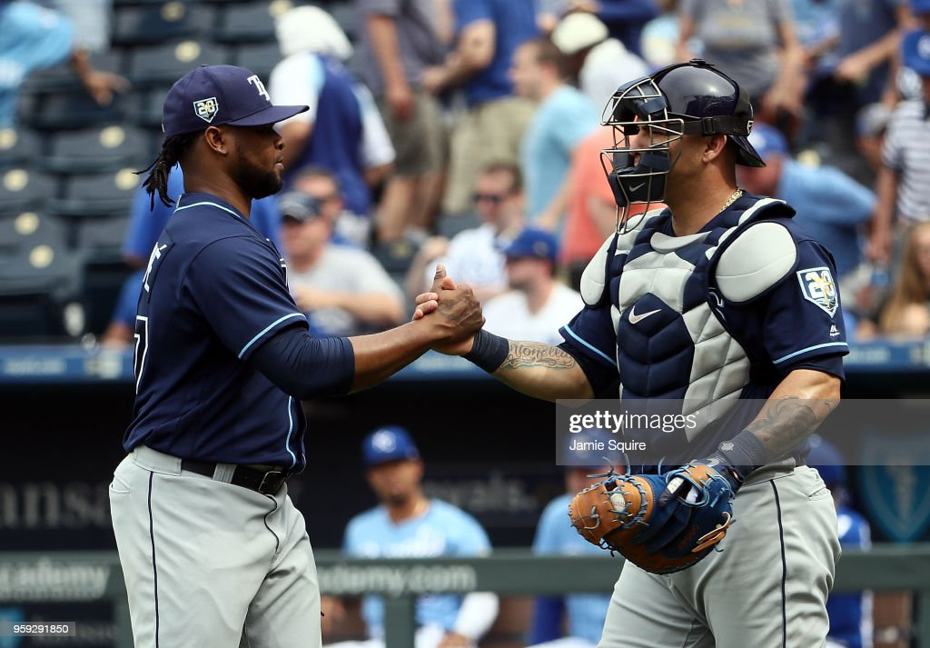 Closer Alex Colome #37 of the Tampa Bay Rays is congratulated by catcher Wilson Ramos #40 after the Rays defeated the Kansas City Royals 5-3- to win the game at Kauffman Stadium on May 16, 2018 in Kansas City, Missouri.