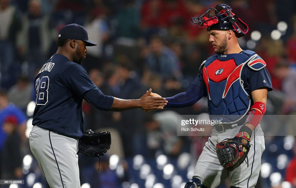 Closer Arodys Vizcaino #38 and catcher Tyler Flowers #25 of the Atlanta Braves congratulate each other after getting the final out in the ninth inning against the Philadelphia Phillies during a game at Citizens Bank Park on May 22, 2018 in Philadelphia, Pennsylvania. The Braves defeated the Phillies 3-1.