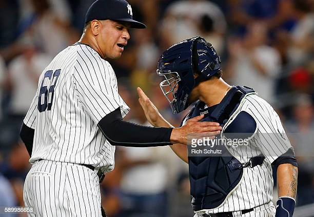 Closer Dellin Betances and catcher Gary Sanchez congratulate their 10 win over the Toronto Blue Jays at Yankee Stadium on August 15 2016 in the Bronx...