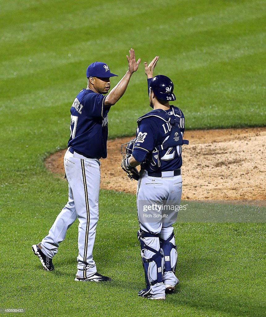 Closer Francisco Rodriguez #57 high fives catcher Jonathan Lucroy #20 of the Milwaukee Brewers after they defeated the New York Mets 5-1 in 13 innings on June 12, 2014 at Citi Field in the Flushing neighborhood of the Queens borough of New York City.