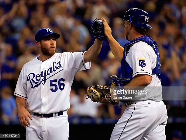 Closer Greg Holland of the Kansas City Royals is congratulated by catcher Erik Kratz after the Royals defeated the Oakland Athletics 64 to win the...