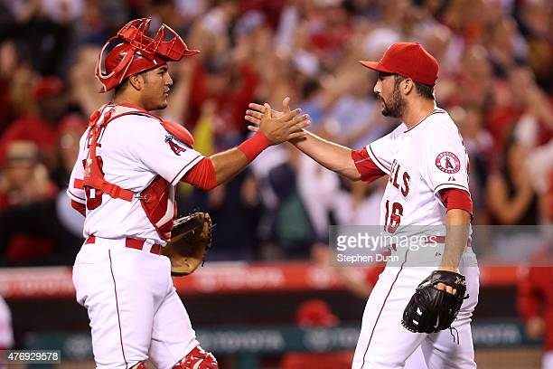 Closer Huston Street and catcher Carlos Perez of the Los Angeles Angels of Anaheim celebrate after Street got the final out and the save against the...