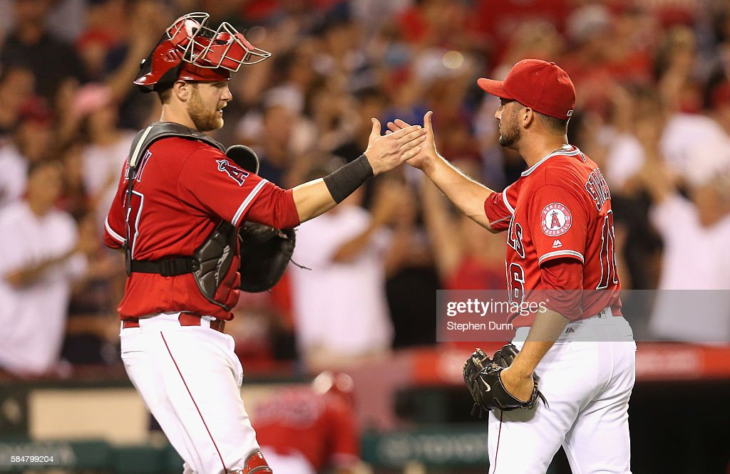 Closer Huston Street #16 and catcher Jett Bandy #47 of the Los Angeles Angels of Anaheim celebrate after Street pitched the ninth inning for the save against the Boston Red Sox at Angel Stadium of Anaheim on July 30, 2016 in Anaheim, California. The Angels won 5-2.