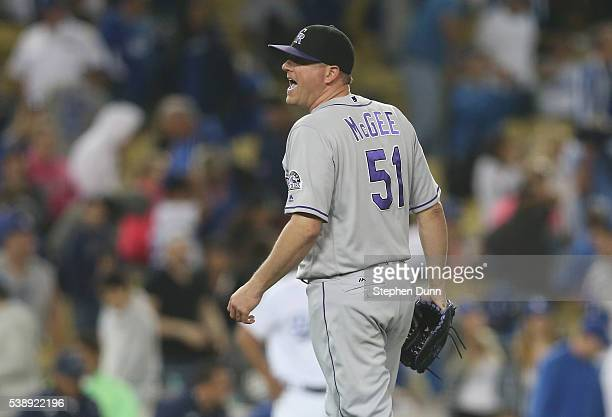 Closer Jake McGee of the Colorado Rockies reacts after getting the final out to pick up the save against the Los Angeles Dodgers at Dodger Stadium on...