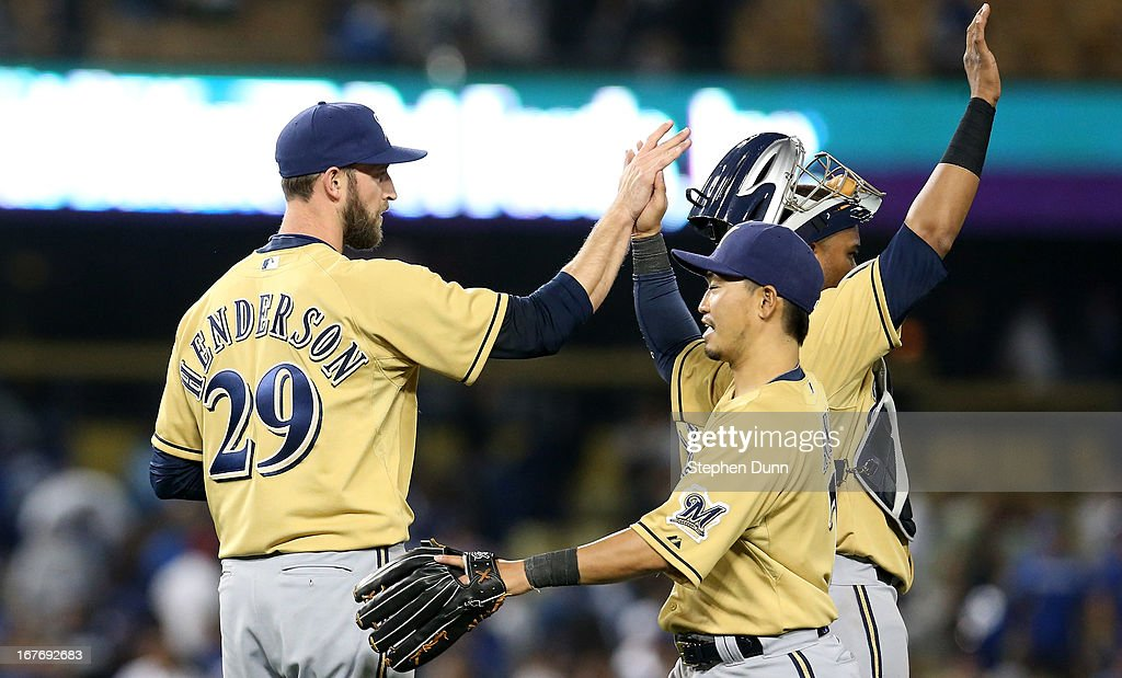 Closer Jim Henderson #29 of the Milwaukee Brewers high fives with Norichika Aoki #7 after getting the final out and picking up a save against the Los Angeles Dodgers at Dodger Stadium on April 27, 2013 in Los Angeles, California. The Brewers won 6-4.