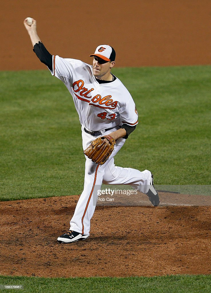 Closer Jim Johnson #43 of the Baltimore Orioles throws to a Kansas City Royals batter during the ninth inning of the Orioles 5-3 win at Oriole Park at Camden Yards on May 8, 2013 in Baltimore, Maryland.
