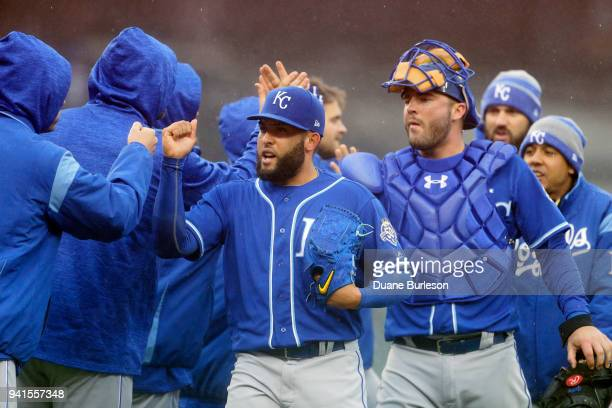 Closer Kelvin Herrera and catcher Cam Gallagher of the Kansas City Royals celebrate with teammates after a 10 win over the Detroit Tigers at Comerica...