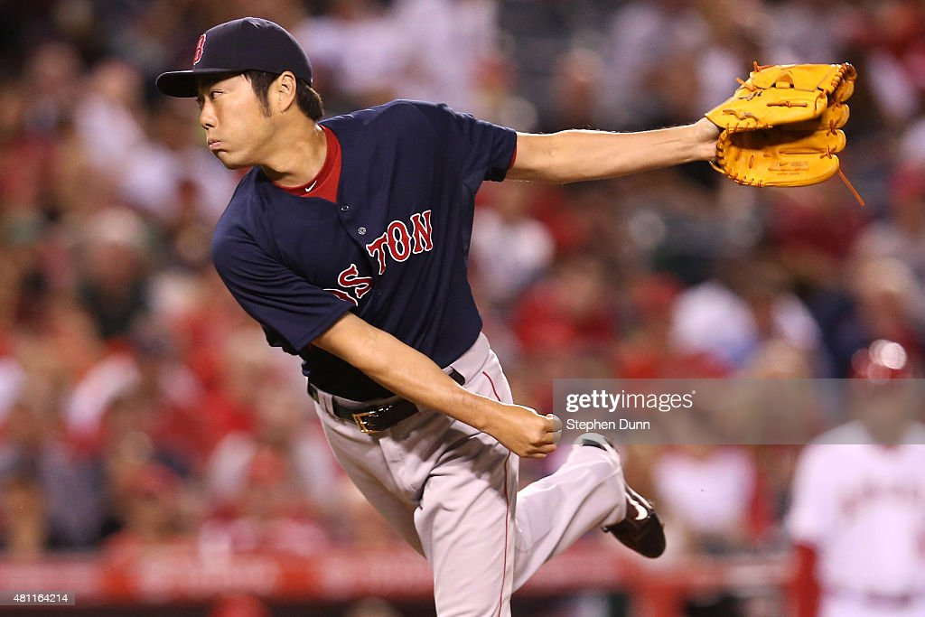 Closer Koji Uehara#19 of the Boston Red Sox throws a pitch in the ninth inning the Los Angeles Angels of Anaheim at Angel Stadium of Anaheim on July 17, 2015 in Anaheim, California. The Angels won 1-0.