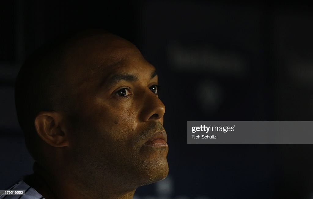 Closer Mariano Rivera #42 of the New York Yankees sits in the dugout after getting the final pout in the eighth inning against the Chicago White Sox in a MLB baseball game at Yankee Stadium on September 4, 2013 in the Bronx borough of New York City. The Yankees won 6-5 as Rivera got a four out save.