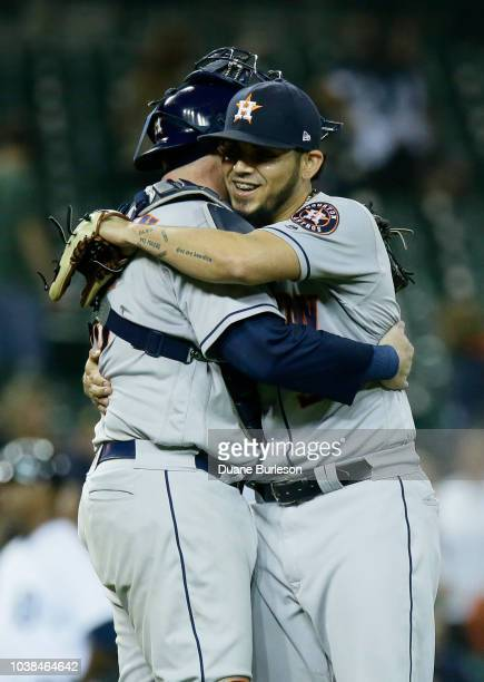 Closer Roberto Osuna of the Houston Astros hugs catcher Brian McCann of the Houston Astros after a win over the Detroit Tigers at Comerica Park on...