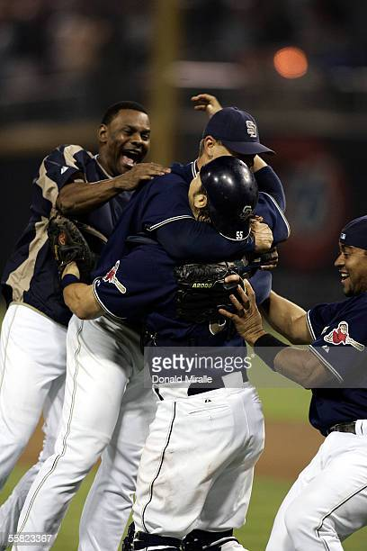 Closer Trevor Hoffman of the San Diego Padres is mobbed by teammates after the final out in the 9th inning against the San Francisco Giants as the...
