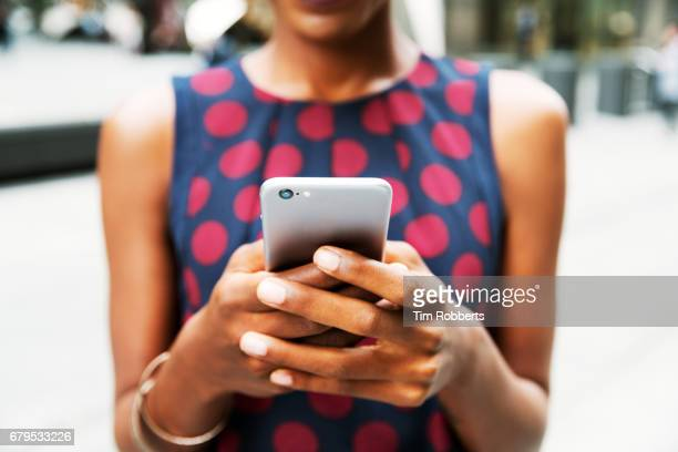 closer up of woman using smart phone - young women stock pictures, royalty-free photos & images