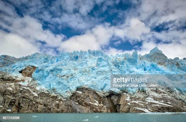 Closer view of glacier Los Leones front blue ice over the rocky soil  in Laguna Sn. Rafael NP.