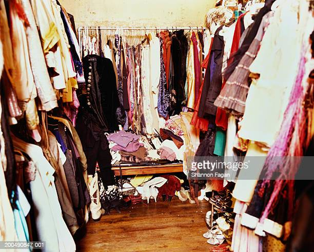 Closet cluttered with clothes