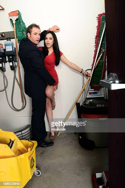 closet couple - janitor stock photos and pictures