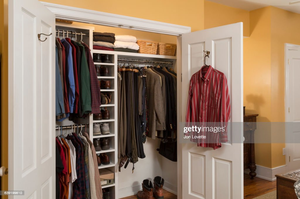 Closet In Home With Mens Clothes Arranged Neat : Stock Photo