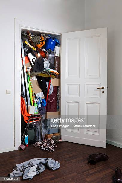 a closet stuffed with various storage items - storage compartment stock pictures, royalty-free photos & images