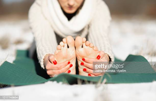 close-uo of feet young woman practicing yoga outdoor.calmness and relax, female happiness. - red nail polish stock pictures, royalty-free photos & images