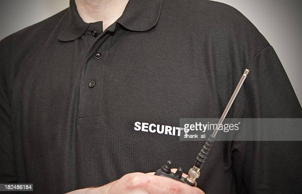 Close-up a security guard's black polo and walkie talkie