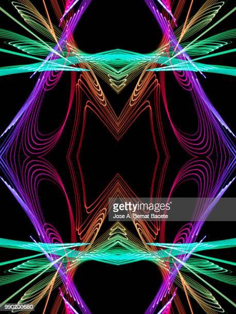 Close-up abstract pattern of intertwined colorful light beams of color pink, green and orange on a  black background.