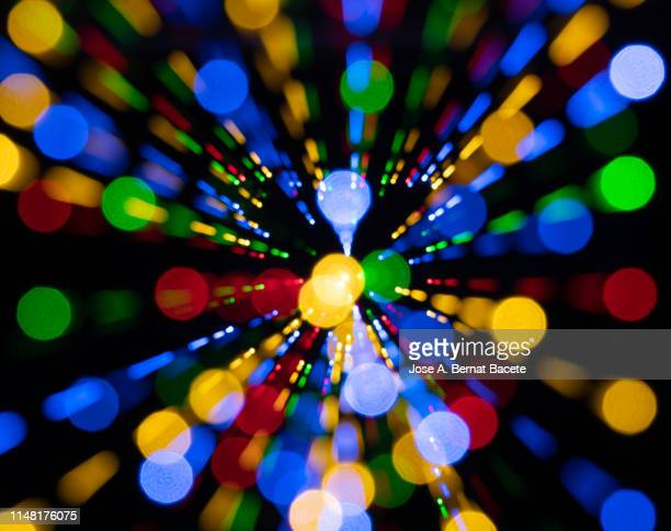 close-up abstract pattern of intertwined colorful red, green and blue lights on a black background. - futurism - fotografias e filmes do acervo