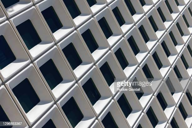 close-up abstract view of square windows in a high rise building - architectural feature stock pictures, royalty-free photos & images